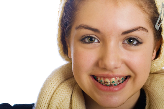 preteen-with-traditional-braces